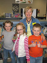 Sheryl with three young readers